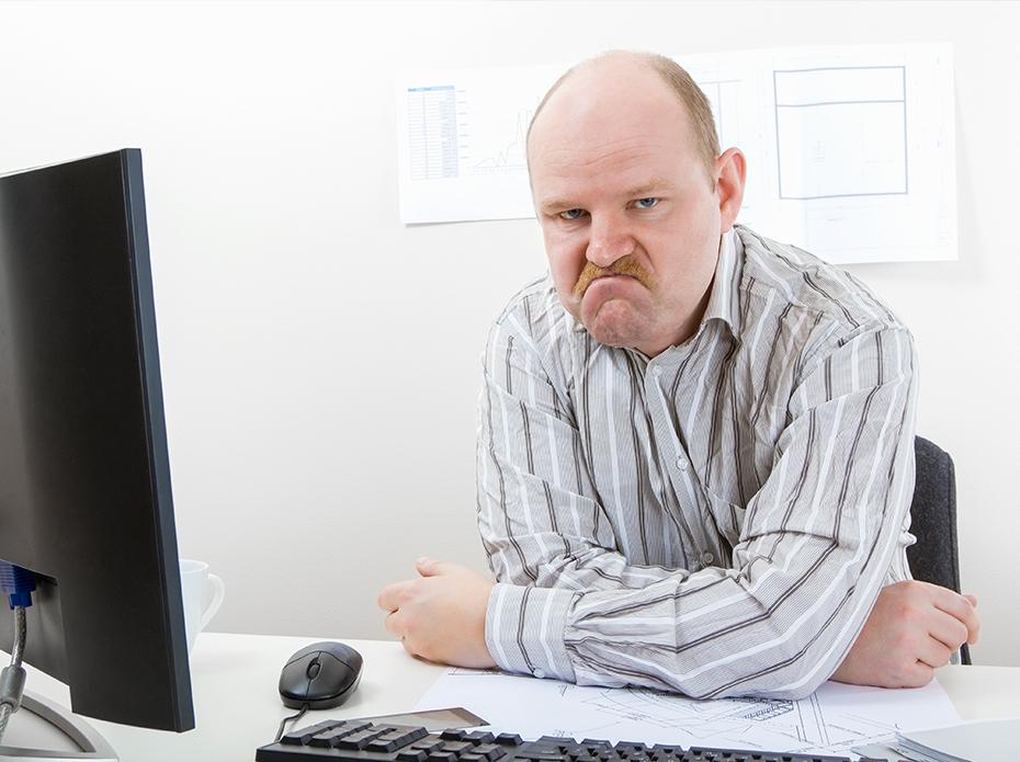 Bild på missnöjd medarbetare